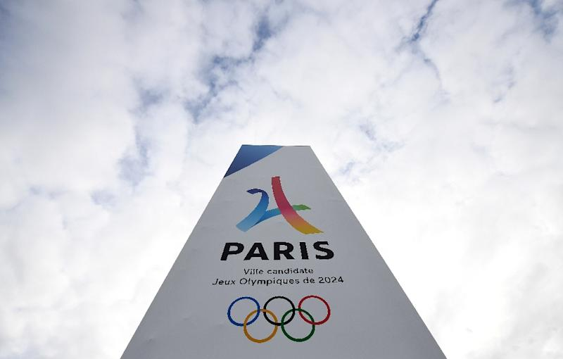 French president pushes Paris Olympic bid, forms government