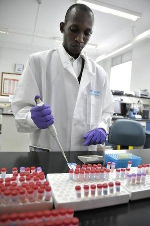 Matovu, a laboratory technician, screens patients' blood samples for HIV/AIDS at Uganda?s Infectious Disease Institute in Kampala