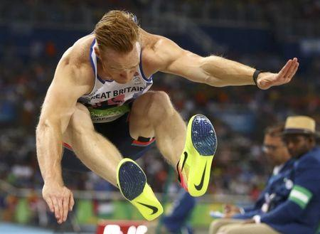 2016 Rio Olympics - Athletics - Final - Men's Long Jump Final - Olympic Stadium - Rio de Janeiro, Brazil - 13/08/2016. Greg Rutherford (GBR) of Britain competes  REUTERS/Kai Pfaffenbach