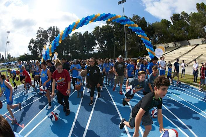 UCLA Athletics - 2018 Dribble for the Cure with the UCLA Men's and Women's Basketball teams in 2018.