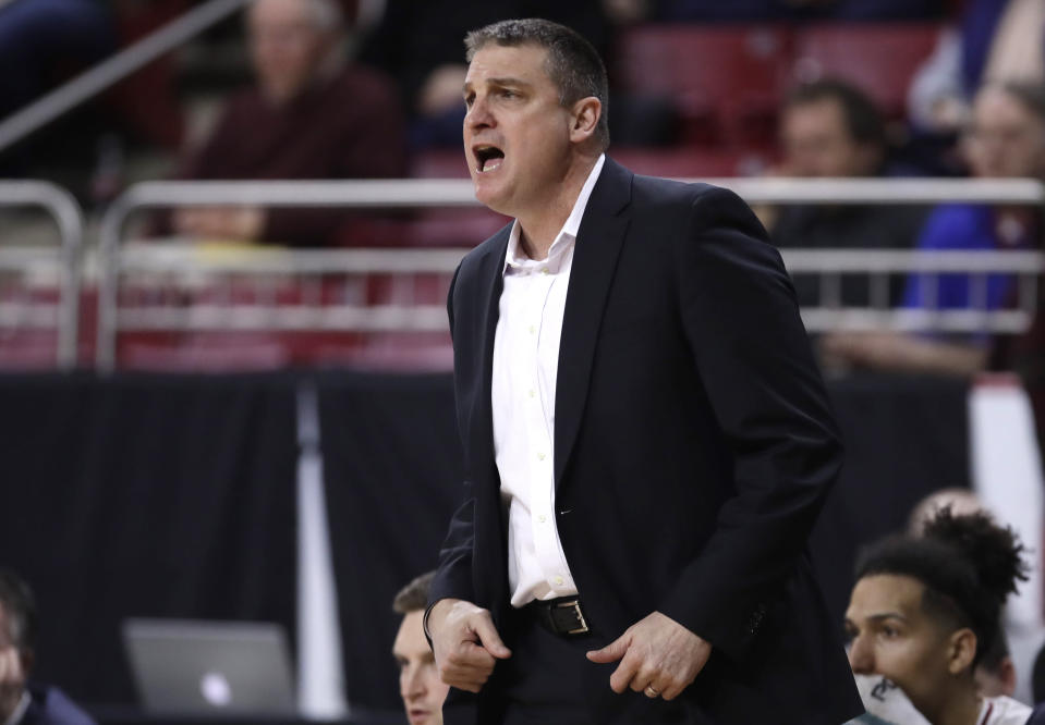 Boston College head coach Jim Christian calls to his players during the first half of an NCAA college basketball game against Louisville in Boston, Wednesday, Feb. 27, 2019. (AP Photo/Charles Krupa)