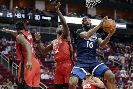 FILE - In this March 10, 2020, file photo, Minnesota Timberwolves forward James Johnson (16) shoots after getting past Houston Rockets forwards Danuel House Jr., left, and Jeff Green (32) during the first half of an NBA basketball game in Houston. Luca Doncic's first experience with the playoffs ended with questions about whether Marcus Morris of the Los Angeles Clippers was intentionally trying to hurt the young Dallas sensation. The Mavericks might have hinted at what they thought through trades and draft picks during this abbreviated offseason. Dallas acquired Johnson and his black belt in karate from the Oklahoma City Thunder after using the club's first-round choice at No. 18 overall on Josh Green, who was a strong defender in his only season at Arizona. (AP Photo/Michael Wyke, File)