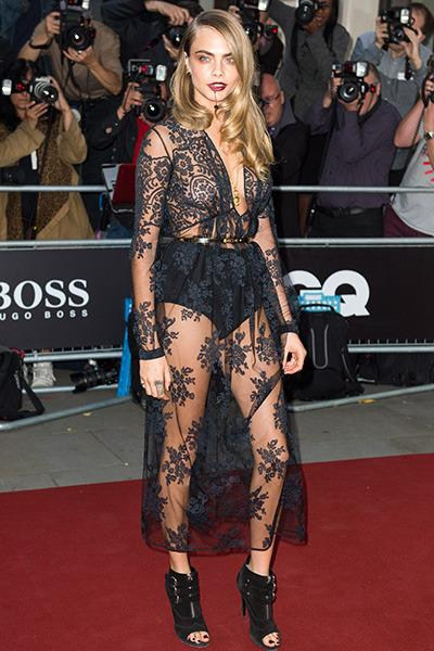 Superstar model Cara Delevingne vamped it up on the red carpet in a completely sheer black dress by Burberry Prosurm.