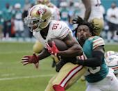 <p>Miami Dolphins cornerback Bobby McCain (28) tackles San Francisco 49ers wide receiver Rod Streater (81), during the second half of an NFL football game, Sunday, Nov. 27, 2016, in Miami Gardens, Fla. (AP Photo/Lynne Sladky) </p>