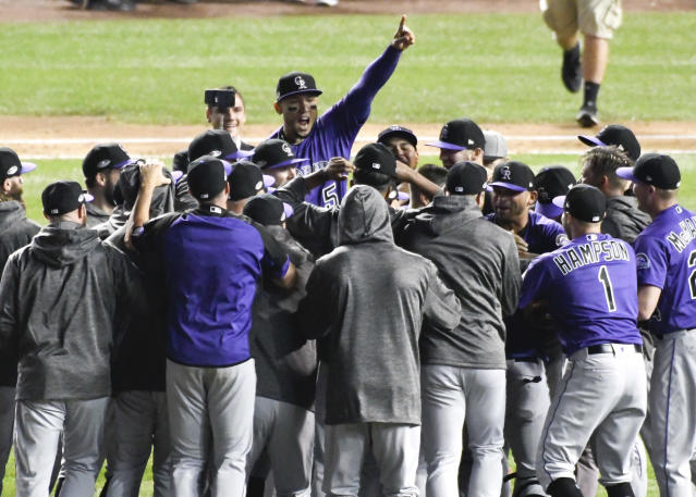 The Colorado Rockies celebrate their win against the Chicago Cubs in the National League wild-card playoff baseball game, Wednesday, Oct. 3, 2018, in Chicago. The Rockies won 2-1. (AP Photo/David Banks)