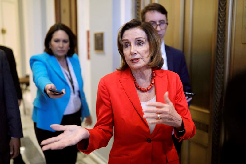 Speaker of the House Pelosi speaks to news reporters ahead of a vote on the coronavirus relief bill on Capitol Hill in Washington