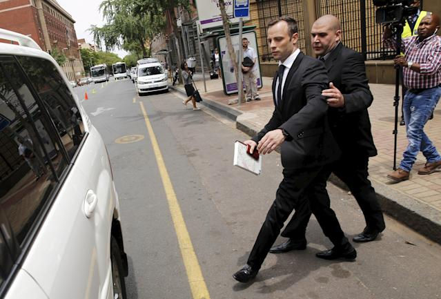 Oscar Pistorius leaves the North Gauteng High Court in Pretoria, South Africa after he was granted bail at his bail hearing, December 8, 2015. REUTERS/Sydney Seshibedi