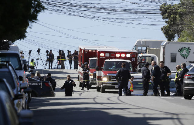 <p>Emergency vehicles are parked and police gather outside a UPS package delivery warehouse where a shooting took place Wednesday, June 14, 2017, in San Francisco. A UPS spokesman says four people were injured in the shooting at the facility and that the shooter was an employee. (AP Photo/Eric Risberg) </p>