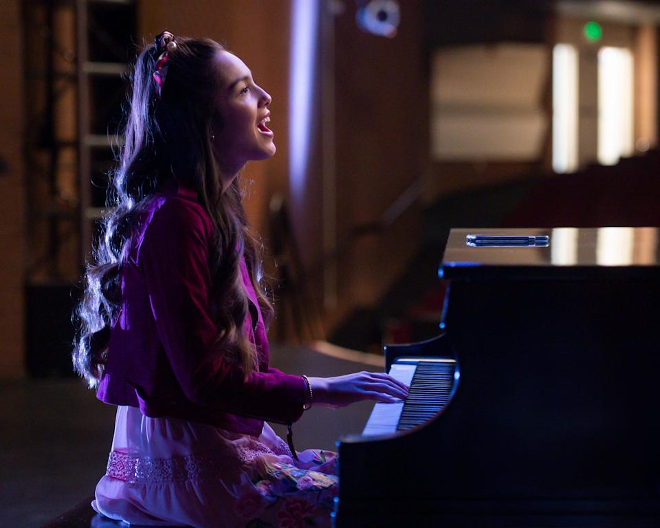 """Nini (Olivia Rodrigo) sings """"The Rose Song"""" at the end of the sixth episode of Season 2 of """"High School Musical: The Musical: The Series."""""""