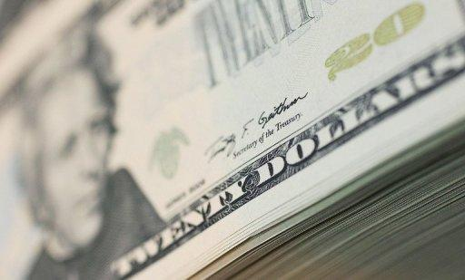 Dollar slips despite strong US jobs report