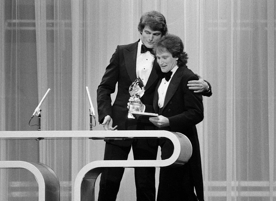 """LOS ANGELES - MARCH 8: Christopher Reeve presenting Robin Williams of """"Mork and Mindy"""" with the Favorite Male Performer in a New TV Program on the 1979 People's Choice Awards show.  Image dated March 8, 1979.  (Photo by CBS via Getty Images)"""