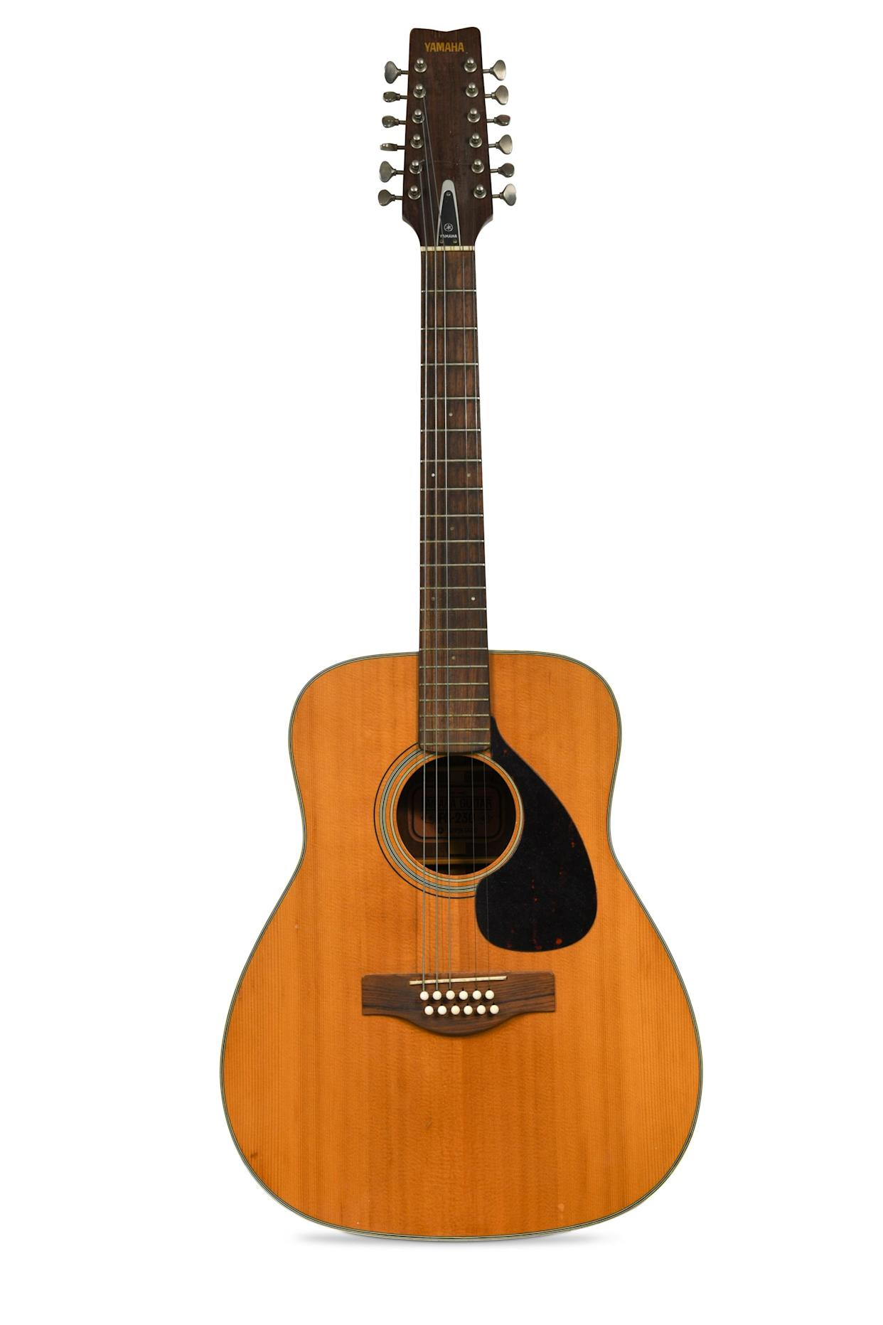 A 12-string Yamaha acoustic guitar once owned by Pink Floyd founder member Syd Barrett is to be sold at auction with a pre-sale estimate of £5,000 to £10,000. (Cheffins/ PA)