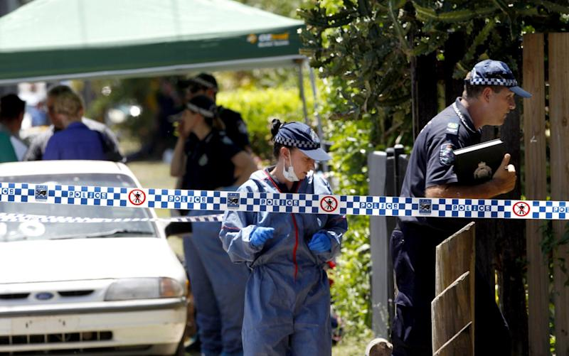 Police attend the house in Manoora, Cairns where eight children were stabbed to death - Credit:  Rex Features