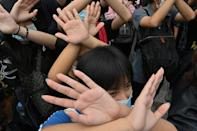 Protesters using hand signals to communicate in Bangkok, a tactic learnt from anti-government demonstrations in Hong Kong