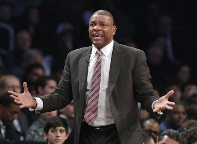 Los Angeles Clippers head coach Doc Rivers complains to a referee in the first half of their NBA basketball game at the Barclays Center, Thursday, Dec. 12, 2013, in New York. (AP Photo/Kathy Willens)