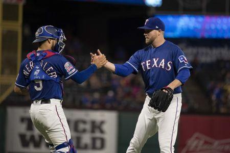 FILE PHOTO: May 4, 2019; Arlington, TX, USA; Texas Rangers catcher Isiah Kiner-Falefa (9) and relief pitcher Shawn Kelley (27) celebrate the win over the Toronto Blue Jays at Globe Life Park in Arlington. Mandatory Credit: Jerome Miron-USA TODAY Sports