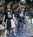 Villanova's Omari Spellman, right, dumps confetti on head coach Jay Wright, holding the trophy after their win over Texas Tech in an NCAA men's college basketball tournament regional final, Sunday, March 25, 2018, in Boston. Villanova won 71-59 to advance to the Final Four. (AP Photo/Charles Krupa)