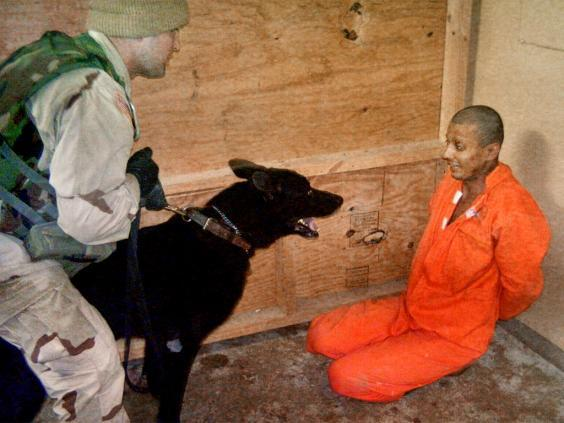 A US soldier confronts an Iraqi detainee in 2004 (AP)