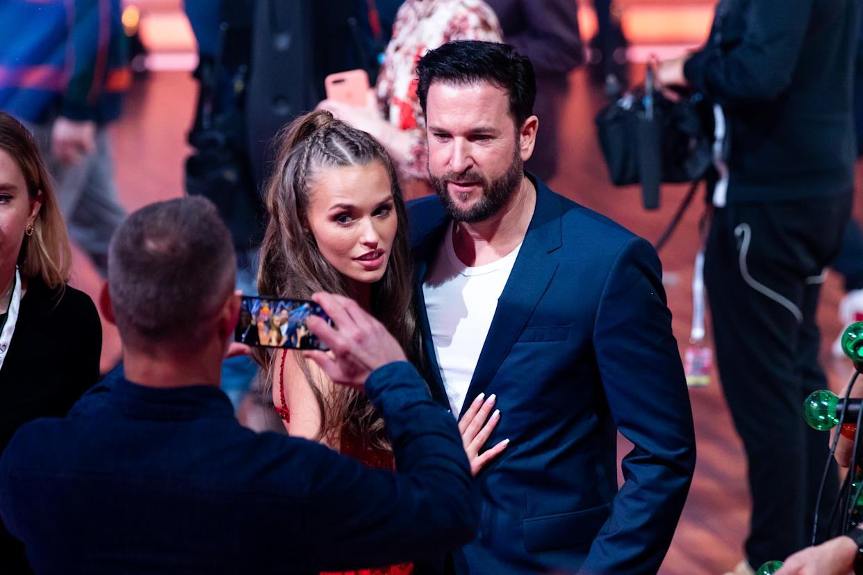 COLOGNE, GERMANY - FEBRUARY 21:  Laura Mueller and Michael Wendler are seen on stage during the pre-show
