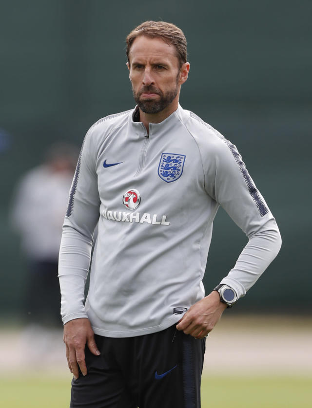 England head coach Gareth Southgate watches his players take part in a training session for the England team at the 2018 soccer World Cup, in the Spartak Zelenogorsk ground, Zelenogorsk near St. Petersburg, Russia, Thursday, June 21, 2018. (AP Photo/Alastair Grant)