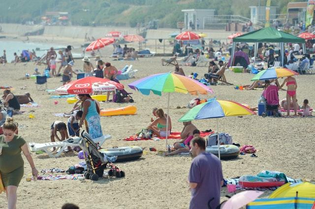 People on an Essex beach during a 2018 heatwave