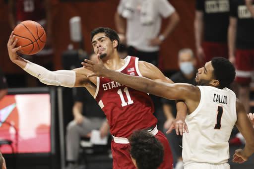 Stanford's Jaiden Delaire (11) and Oregon State's Maurice Calloo (1) fight for a rebound during the first half of an NCAA college basketball game in Corvallis, Ore., Monday, Jan. 4, 2021. (AP Photo/Amanda Loman)