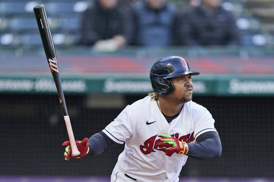 Cleveland Indians' Jose Ramirez watches his ball after hitting a solo home run in the fourth inning of a baseball game against the Chicago Cubs, Tuesday, May 11, 2021, in Cleveland. (AP Photo/Tony Dejak)