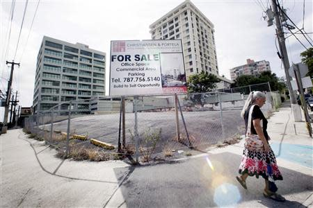 A billboard announces office space and parking for sale in San Juan