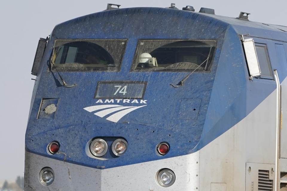 The front windows of an Amtrak train engine are shown, Monday, Sept. 27, 2021, near Joplin, Mont. The engine was part of a train that derailed Saturday, killing three people and injuring others. Federal investigators are seeking the cause of the derailment. (AP Photo/Ted S. Warren)