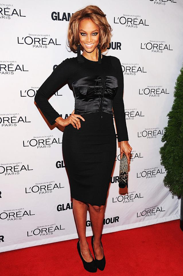 Tyra Banks smized for the cameras as she rocked the red carpet in a form-fitting LBD. (11/12/12)