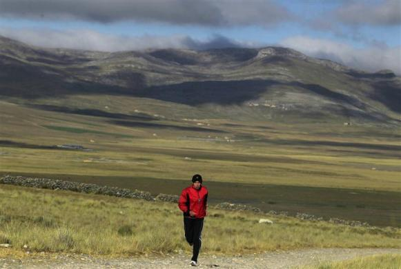 "Marathon runner Gladys Tejeda, the first Peruvian athlete who qualified for the 2012 London Olympic Games, runs during her training in the Andean province of Junin May 15, 2012. A private company will take Gladys' mother Marcelina Pucuhuaranga, 69, to London as part of the ""Thank you Mom"" program. For Pucuhuaranga, who received her first passport, it will be the first time traveling out of Peru. The program will take about 120 mothers of different athletes around the world to attend the games. Tejeda, the youngest of nine children, returned to her hometown to visit her mother and to focus on training where she will run more than 20 km every day in the highlands (over 4,105 meters above sea level)."