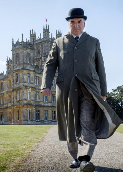 """This image released by Focus features shows Jim Carter as Mr. Carson in a scene from """"Downton Abbey."""" The film was nominated for a GLAAD Media Award for outstanding wide release film on Wednesday, Jan. 8, 2020.  (Jaap Buitendijk/Focus Features via AP)"""