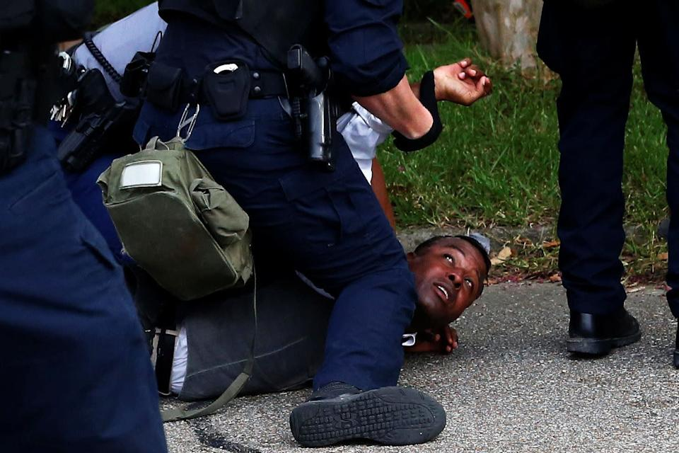 A demonstrator is detained during protests in Baton Rouge, Louisiana, U.S., July 10, 2016. REUTERS/Shannon Stapleton TPX IMAGES OF THE DAY