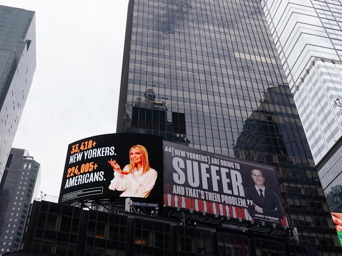 A billboard by The Lincoln Project is seen in Times Square on 25 October  2020 in New York City ((AFP via Getty Images))