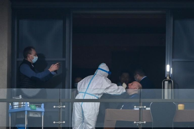 The World Health Organization (WHO) team investigating the origins of the pandemic, seen here giving swab samples after arriving in Wuhan, were accused of allowing China t odictate the parameters of their mission