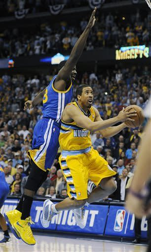 Denver Nuggets guard Andre Miller, right, drives past Golden State Warriors forward Draymond Green, left, for the game-winning basket in the second half of Game 1 in the first round of the NBA basketball playoffs on Saturday, April 20, 2013, in Denver. (AP Photo/Chris Schneider)