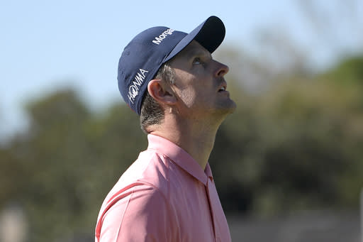 Justin Rose, of England, reacts after missing a putt on the 17th green during the first round of the Arnold Palmer Invitational golf tournament at Bay Hill, Thursday, March 7, 2019, in Orlando, Fla. (AP Photo/Phelan M. Ebenhack)