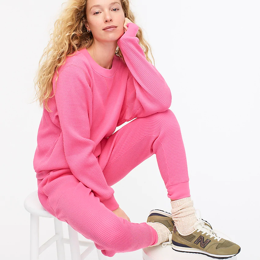 """<h3><h2>J.Crew Waffle Pullover & Jogger Set</h2></h3><br><strong>Available Sizes: XXS-3X </strong><br>J.Crew's waffle set is made from comfy cotton, so it's ideal for year-round usage. Layer these punchy pink pieces with pretty much anything from a button-down to your favorite tee. The plus sizes in the pullover are sold out, but there's plenty left in the joggers! <br><br><em>Shop <strong><a href=""""https://www.jcrew.com/us/p/womens_category/sweatshirts_sweatpants/matching_sets/waffle-crewneck-pullover/AS037"""" rel=""""nofollow noopener"""" target=""""_blank"""" data-ylk=""""slk:J.Crew"""" class=""""link rapid-noclick-resp"""">J.Crew</a></strong></em><br><br><strong>J.Crew</strong> Waffle crewneck pullover, $, available at <a href=""""https://go.skimresources.com/?id=30283X879131&url=https%3A%2F%2Fwww.jcrew.com%2Fus%2Fp%2Fwomens_category%2Fsweatshirts_sweatpants%2Fmatching_sets%2Fwaffle-crewneck-pullover%2FAS037"""" rel=""""nofollow noopener"""" target=""""_blank"""" data-ylk=""""slk:J. Crew"""" class=""""link rapid-noclick-resp"""">J. Crew</a><br><br><strong>J.Crew</strong> Waffle jogger pant, $, available at <a href=""""https://go.skimresources.com/?id=30283X879131&url=https%3A%2F%2Fwww.jcrew.com%2Fp%2FAS051%3Fcolor_name%3Dbright-begonia"""" rel=""""nofollow noopener"""" target=""""_blank"""" data-ylk=""""slk:J. Crew"""" class=""""link rapid-noclick-resp"""">J. Crew</a>"""