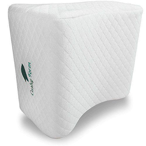 """<p><strong>Cushy Form</strong></p><p>amazon.com</p><p><strong>$21.97</strong></p><p><a href=""""https://www.amazon.com/dp/B01A8TPWS2?tag=syn-yahoo-20&ascsubtag=%5Bartid%7C10049.g.35031720%5Bsrc%7Cyahoo-us"""" rel=""""nofollow noopener"""" target=""""_blank"""" data-ylk=""""slk:Shop Now"""" class=""""link rapid-noclick-resp"""">Shop Now</a></p><p>For those who suffer from knee pain, sciatica, or overheating in the night, finding a comfortable sleeping position is what keeps you tossing and turning — even if you're ready to shut your mind off and go to sleep already.</p><p> This top-selling memory foam pillow from Cushy Form fits between your knees and keeps your spine in better alignment. Plus, its breathable cover helps keep your body cool under the covers.</p>"""