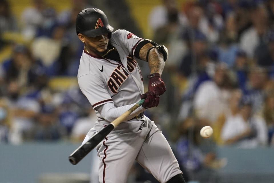 Arizona Diamondbacks' Ketel Marte connects for a three-run home run during the seventh inning of the team's baseball game against the Los Angeles Dodgers on Tuesday, Sept. 14, 2021, in Los Angeles. (AP Photo/Marcio Jose Sanchez)
