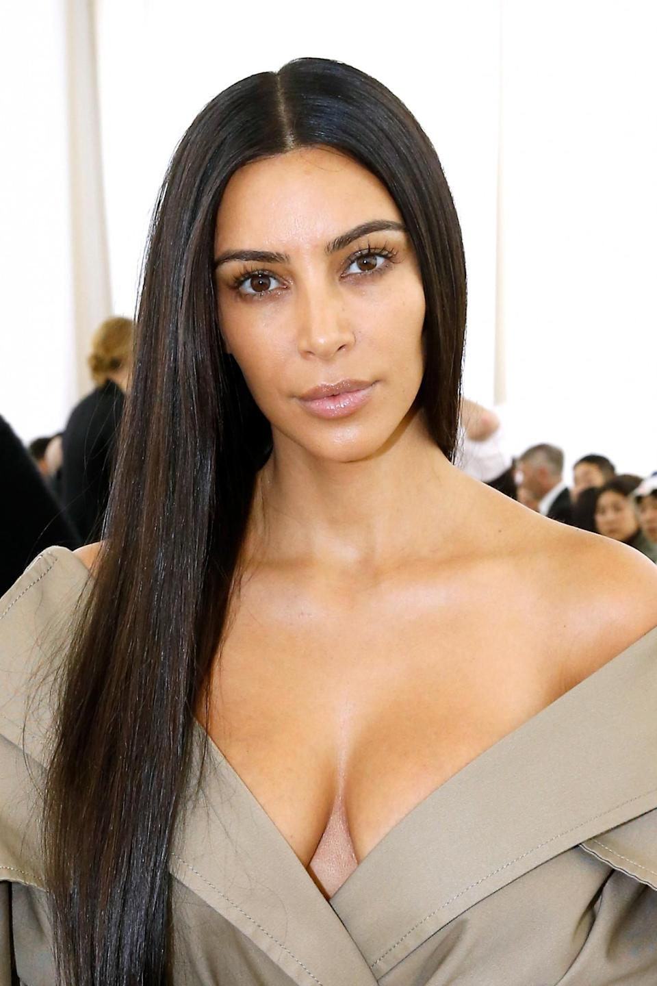 <p>Known for her heavily contoured look, Kim Kardashian turned a few heads when she showed up to the front row at Balenciaga's Paris show without a stitch of make up. [Photo: Getty/Bertrand Rindoff Petroff] </p>