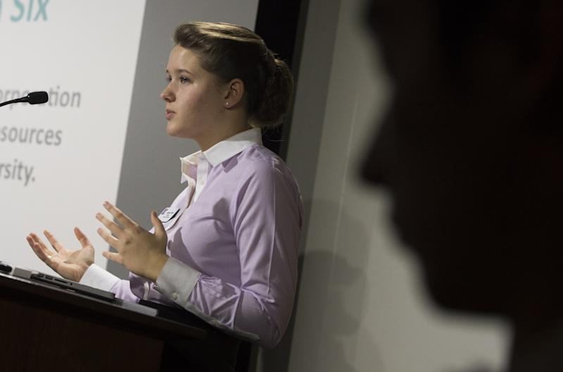 American University student body president Sophia Wirth talks about the Sexual Assault Awareness and Prevention Task Force dealing with campus sexual assaults and violence during a school forum, November 10, 2014 (AFP Photo/Saul Loeb)