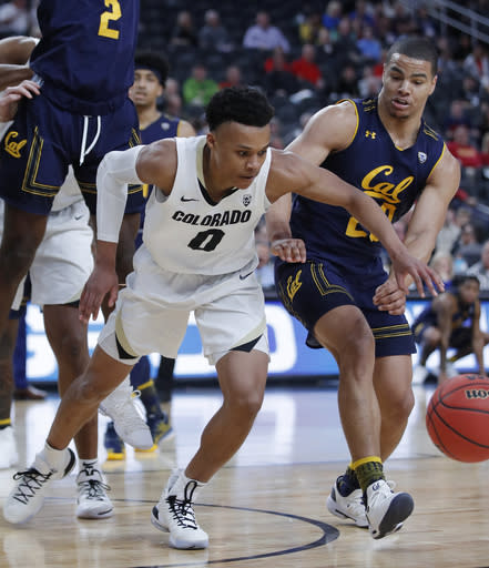 Colorado's Shane Gatling (0) and California's Matt Bradley vie for the ball during the first half of an NCAA college basketball game in the first round of the Pac-12 men's tournament Wednesday, March 13, 2019, in Las Vegas. (AP Photo/John Locher)