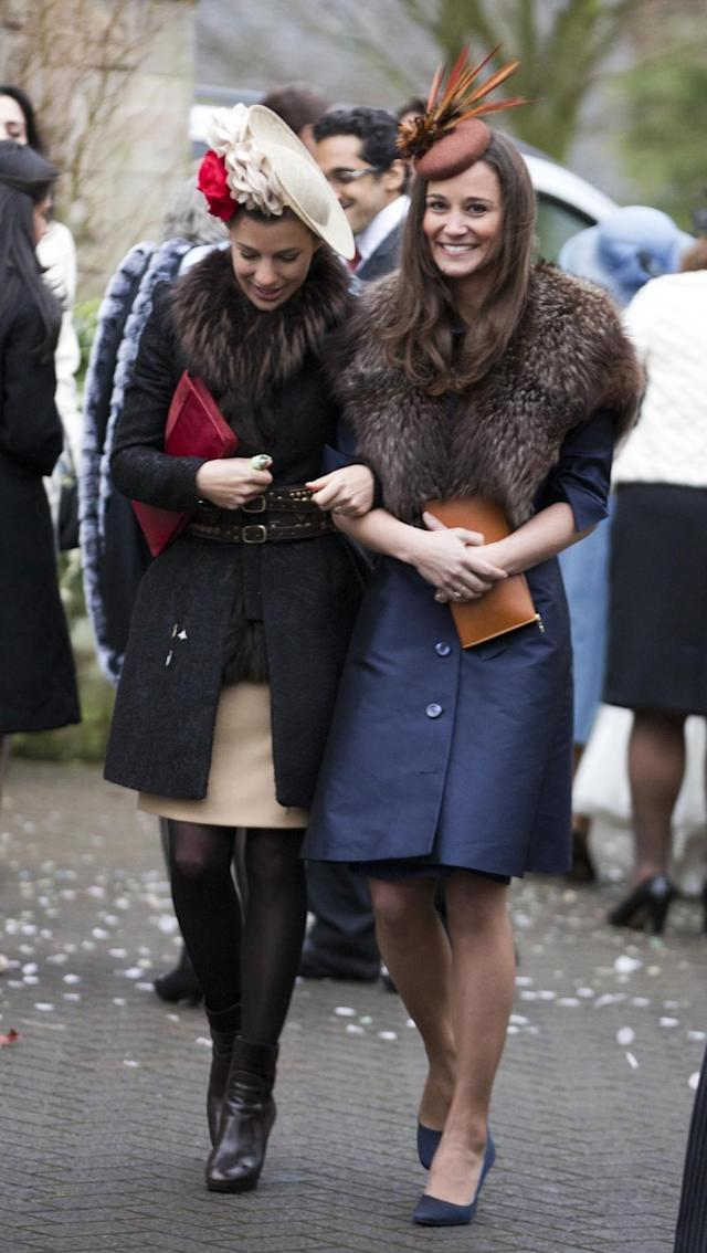 <p>What does one wear to a wedding in Northern Ireland in December? A warm coat and fur stole in autumnal, earthy shades.<em> (Photo: Rex)</em> </p>