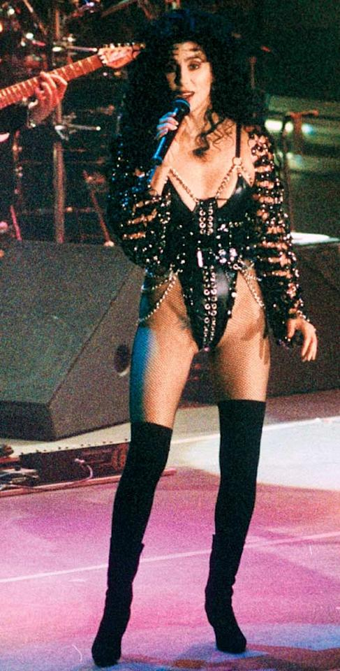 """<b>1992:</b> """"I never had a rocker period, but this was perfect for the 'Love Hurts' tour. It was patent leather with chains, grommets, lacing, and fishnets. I've been wearing fishnets my whole life. If I am buried in a short skirt, I am wearing fishnets with it.""""   <a href=""""http://news.instyle.com/2010/11/17/secrets-from-christina-aquileras-burlesque-makeup-artist/?xid=omg-burlesque-makeup?yahoo=yes"""" target=""""new"""">Secrets From Christina Aquilera's 'Burlesque' Makeup Artist</a> Brian Rasic/Rex USA"""