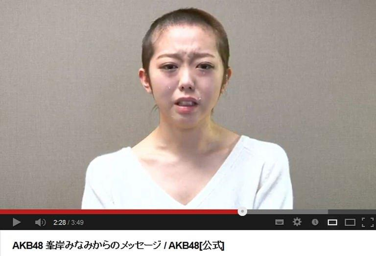 A YouTube screen grab shows Minami Minegishi, a member of pop group AKB48, with her hair cut off, January 31, 2013