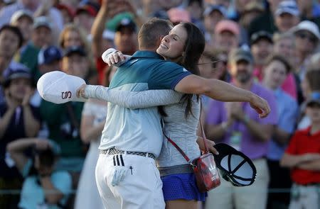Sergio Garcia of Spain embraces his fiance Angela Akins after he won the 2017 Masters golf tournament in a playoff against Justin Rose of Englans at Augusta National Golf Club in Augusta, Georgia, U.S., April 9, 2017. REUTERS/Lucy Nicholson