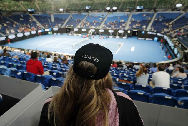 Tennis - Australian Open - Fourth Round - Melbourne Park, Melbourne, Australia, January 21, 2019. Supporter of Switzerland's Roger Federer watches the match between Russia's Anastasia Pavlyuchenkova and Sloane Stephens of the U.S. REUTERS/Adnan Abidi