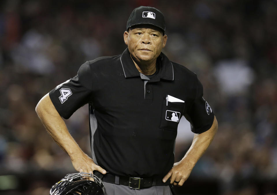 FILE - In this June 2, 2018, file photo, Major League baseball umpire Kerwin Danley (44) is shown during the first inning of a baseball game between the Arizona Diamondbacks and the Miami Marlins in Phoenix. Danley became the first African-American umpire crew chief in Major League Baseball during a series of retirements, promotions and additions announced Wednesday, Feb. 26, 2020. (AP Photo/Rick Scuteri, File)