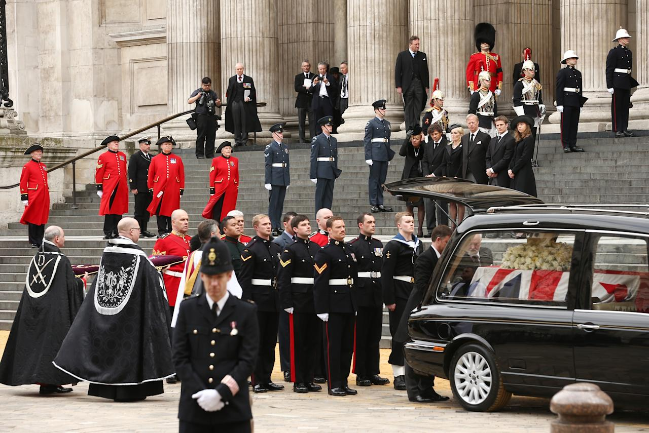 LONDON, ENGLAND - APRIL 17:  (L-R) Carol Thatcher, Marco Grass, Sarah Thatcher, Mark Thatcher, Michael Thatcher and Amanda Thatcher look on from the steps of St Paul's Cathedral as the coffin is placed in the hearse after the Ceremonial funeral of former British Prime Minister Baroness Thatcher at St Paul's Cathedral on April 17, 2013 in London, England. Dignitaries from around the world today join Queen Elizabeth II and Prince Philip, Duke of Edinburgh as the United Kingdom pays tribute to former Prime Minister Baroness Thatcher during a Ceremonial funeral with military honours at St Paul's Cathedral. Lady Thatcher, who died last week, was the first British female Prime Minister and served from 1979 to 1990.  (Photo by Dan Kitwood/Getty Images)